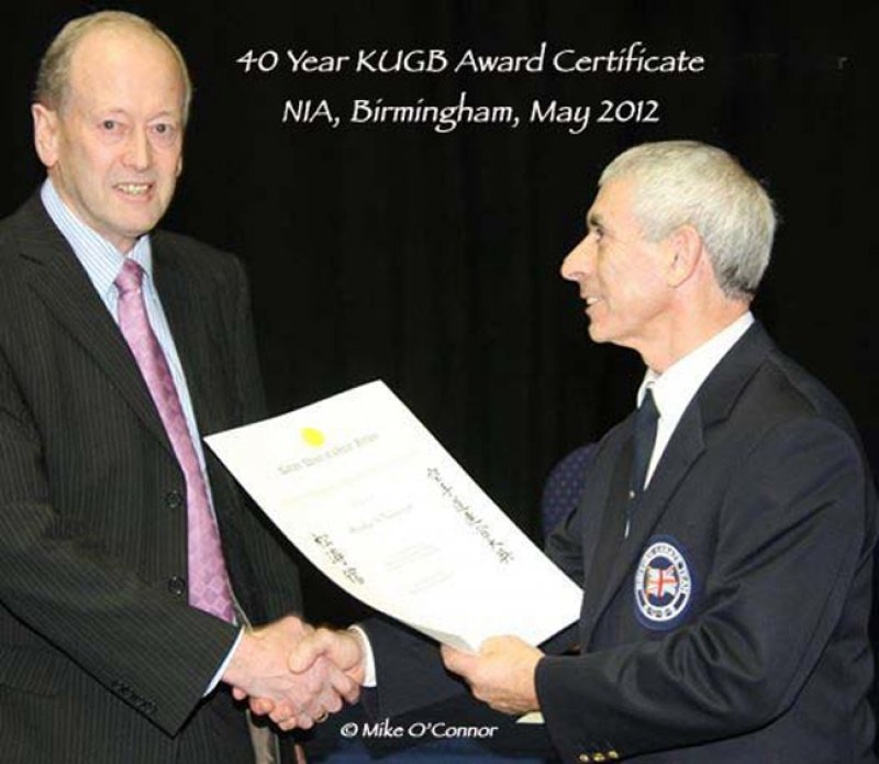 <p>Sensei Dudley Wheatcroft receives his 40 year KUGB member award from Sensei Andy Sherry at the KUGB National Championships.</p>